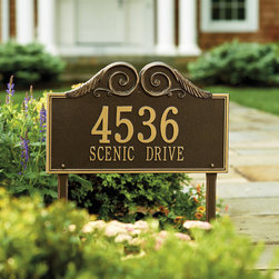 "Frontgate - Regal Standard Address Plaque - Make a statement at the entrance to your home. Crafted from powdercoated cast aluminum. Available in three finishes, all with golden numbers and/or letters. One line version holds up to five 4-1/2"" numbers. Select from a wall mount or lawn plaque. With our Regal Address Plaque, a crescendo of scrolls announces your address in elegant style. Staked in your yard or mounted on the gateway, this quintessential entrance ornament is crafted from powdercoated cast aluminum, so it will retain its beauty for decades to come. Personalize yours with five 3"" characters, and add a second line up to seventeen 1-1/4"" characters.. . . . . Wall-mount hardware or stakes for in-ground installation included. Personalized items are nonreturnable. Please check for accuracy; personalized orders cannot be modified, cancelled, or returned after being placed."