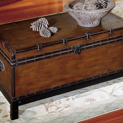Steve Silver Co. - Voyage Trunk Cocktail Table w Metal Flap Lock - Trunk style table in a rectangle shape. Sitting atop square legs this trunk has a leather like finish. Nail head trim around the edges. Opening with a metal flap lock. Decorative leather like trim & straps with metal pulls on the sides. Multi-step Antique Cherry finish. Traditional style. Corner block construction. Tongue and groove joints. Select hardwood solids material. Some assembly required. Select hardwood solids material. 44 in. W x 24 in. D x 21 in. H (85 lbs.)