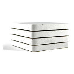 Zeitgeist Factory - White Coasters, Set of 4 - This coaster's the clear winner when it comes to function and durability. Each set is handmade from recycled countertop stone dust, then sealed with natural wax and finished with cork.