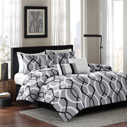 Home Essence - Home Essence Ellie 7 Piece Comforter Set - Make a contemporary statement in your bedroom with the Ellie collection. The comforter and shams feature a bold, circular geometric pattern in black and white against a grey ground reversing to a solid light grey color. The set includes a solid black bedskirt. Three pintucked and pieced decorative pillows add dimention and texture to the whole look. Comforter& sham face : 100% polyester micro fiber 75gsm print. Reverse: polyester microfiber 75gsm solid. Comforter with 200gsm poly fill. Bedskirt: non woven platform and micro fiber 75gsm drop; Pillow: 100% polyester cover with poly fill.
