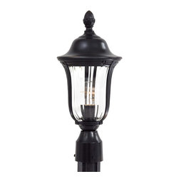 Frontgate - Andover Outdoor Post Lantern - Small - Cast aluminum construction for durability. Clear optic mouth-blown glass. Heritage finish, hand-applied multi-step finish. Metal candle sleeves. CFL candelabra or medium base bulbs accepted. Our European-inspired Andover Outdoor Lighting shimmers through dimensional mouth-blown glass, a timeless upgrade to your home's exterior. The lanterns feature a hand-applied Heritage finish and project a warm glow on your patio, porch, or outdoor seating area.  .  .  .  .  . Incandescent light . Professional installation recommended . Post sold separately. Made in the USA.