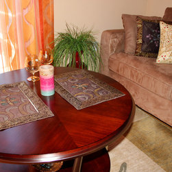 Living Room Decor - Coffee brown hand painted placemats give this table a nice elegant touch while the matching hand painted pillow covers bring beauty to the sofa in combination with the soft velvet beige pillow covers from Banarsi Designs.