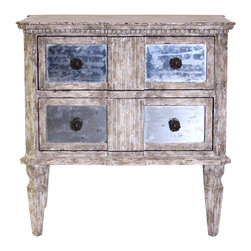 Ribbed Chest with Antiqued Mirror - This two-drawer chest is a showcase of antique furniture's architectural details, rendered into a transitional piece by a rubbed wood finish and made breathtaking with four hand-antiqued mirrored panels set into the drawers.  A classical Doric pilaster divides the mirrors at the center and blends seamlessly into the attractive dentil molding just below the chest's beveled top.  The chest stands on tapering fluted legs and is finished with dark metal drawer pulls at the center of each fascinating square of inlaid mirror.