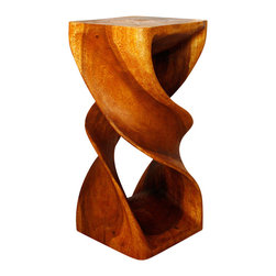 Kammika - Double Twist Stool Sust Wood  14x14 x 30 inch H w Eco Friendly Livos Oak Oil Fin - Our Sustainable Monkey Pod Wood Double Twist Stool 14 inch x 14 inch x 30 inch height with Eco Friendly, Natural Food-safe Livos Oak Oil Finish is a visual delight in any setting. It has graceful one-quarter turns that will add a sense of serenity and beauty to your home. You can use it as an end table, display stand or stool; two together can serve as a striking coffee table. Carved from a single piece of Monkey Pod wood and finished with Livos Oak Oil, appealing to the viewer from any angle, each is a Work of Art! Craftspeople from the Chiang Mai area in Northern Thailand create these pieces with the simplest of tools. Sustainable Monkey Pod wood (Acacia, Koa, Rain Tree grown for wood carving) is dried, carved, sanded, and rubbed in Livos Oak oil polished to a water resistant and food safe matte finish. The light and dark portions turn to darker shades of brown over time and the alkaline in the oils creates a honey orange color. The oils are translucent, so the wood grain detail is highlighted. There is no oily feel, and cannot bleed into carpets. Made from the branches of the Acacia tree, where each branch is cut and carved to order (allowing the tree to continue growing), the wood is kiln dried, carved and sanded, creating a sturdy place to sit. We make minimal use of electric hand sanders in the finishing process. All products are dried in solar or propane kilns. No chemicals are used in the process, ever. All products finished by hand rubbed oils. Each piece is packaged with cartons from recycled cardboard with no plastic or other fillers. The color and grain of your piece of Nature will be unique, and may include small checks or cracks that occur when the wood is dried. Sizes are approximate. Products could have visible marks from tools used, patches from small repairs, knot holes, natural inclusions or holes. There may be various separations or cracks on your piece when it arrives. There may be some slight variation in size, color, texture, and finish color.Only listed product included.