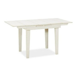 """Eastlake Extending Rectangular Table, 36.5 x 29.5"""", Almond White - Lift-up leaves on either side let you expand this table's top in seconds. Between meals, simply drop the leaves and place the table against the wall to preserve space. It's crafted with a planked top and tapered legs, and painted and distressed by hand for a charmingly timeworn look. 36.5"""" long x 29.5"""" wide x 30"""" high; extends to 56"""" long Crafted with a solid hardwood frame. Features two breadboard extensions. Finished in Almond White. Perfect for small spaces. View our {{link path='pages/popups/fb-dining.html' class='popup' width='480' height='300'}}Furniture Brochure{{/link}}."""