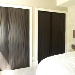 Closet Doors by Soelberg Industries - Out textured wall panels can be used to bring some life to otherwise boring closet sliding doors. We can custom make doors to fit the exact sizes you need. They hang with standard closet sliding door hardware. For more information or to place an order, contact us directly at 801-434-9450.