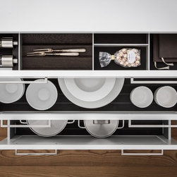 SieMatic Interior Design System - SieMatic drawers and pullouts with smoked chestnut inserts provide a place for everything - while also protecting utensils, plates, bowls, and pots from slipping when drawers are opened and closed.