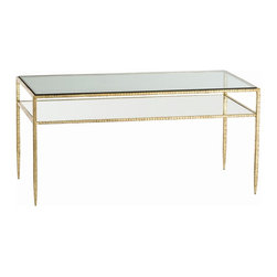 Arteriors - Dean Cocktail Table, Gold Leaf - Heavy metal meets high style in this graceful cocktail table. The metal frame rests atop legs so slender they appear to be en pointe. The top is inset with glass, allowing the lower shelf's finish to shine through.
