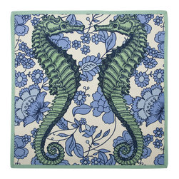 """Thomas Paul - Seahorse Vineyard Napkin - The handmade Thomas Paul Seahorse Vineyard Napkin features hand screened prints on 100% cotton. The napkin features the nautical image of a seahorse against a floral background. The blue & green print adds a pop of nautical color to your kitchen or dining room.  These will delight guests of your own, but they also make a great housewarming or wedding present.     About the Artist: After graduating from NYC's famed FIT, Thomas Paul started his career as a colorist and designer at a silk mill. Eventually, he leveraged his knowledge of silk materials & print to launch a neckwear line of his own. Over time, Paul loved the idea of applying menswear print and design into a collection of home decor, which is what we see in his goods today. His background has embedded in him a passion for quality production techniques. Even as his brand grows, he continues to ensure all of his prints are hand screened - a slow, detailed process that results in each piece being a unique piece of artwork. Paul also pushes the envelope in terms of bold prints and hand ground materials.       """"My vision for the thomaspaul brand has always been about combining classic design motifs from different periods in textile design. Incorporating anything from an 18th century Damask pattern to a camouflage print. The unifying thread between so many different styles is to change the designs so they are updated for today. For me this means changing the scale, so they are always bold, and reducing down the colors and details, so most designs are reduced to two or three colors and become very flat, bold prints. I am always looking to vintage fabrics and motifs for inspiration and new ideas, but always try to update these to look good for today."""" - Thomas Paul   Product Details:"""