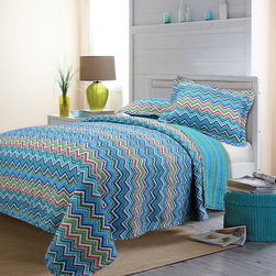 None - Blue ZigZag 3-piece Quilt Set - Fall asleep feeling comfortable and stylish when you add this colorful three-piece quilt set to your bed. The funky zigzag pattern turns your bed into a place where you will want to relax, and the bright colors are sure to make an impression.