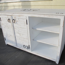 Media console/Bar - This is a version of our storage locker, it was a special order media cabinet, it is constructed with a blend of new and vintage materials. This console was handcrafted and has a well worn look to it as if it's been around a long time,we can custom build this to any size and or color,and with any custom lettering.