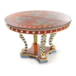 Highland Thistle Dining Table | MacKenzie-Childs - A masterwork of hand decoration from our artisans in Aurora, adorned with signature thistle flowers, each Highland Thistle Dining Table offers layers of decorative detail. The edge of the tabletop is striped in purple and green, followed by a decorated apron in rich Moroccan red with brass half-dome beads and gold banding. Each S-shaped leg features our hand-painted classic Courtly Check pattern on the front and sides, ending with gold at the base. The interior of the legs are painted in chartreuse. The base of the table is decorated in a diamond-and-stripe motif of rose, blue, and chartreuse, and is finished with blue and brass tack feet and Courtly Check-accented legs. Imported hardwood. With two leaves included, it seats four to eight.