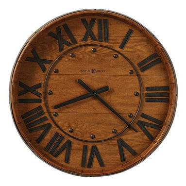 Howard Miller - Howard Miller Wine Barrel 25 in. Wall Clock - 625453 - Shop for Clocks from Hayneedle.com! Your rustic kitchen includes aged and beloved pieces such as a thick butcher block and the Howard Miller Wine Barrel 25-in. Wall Clock. You can almost smell the hearty beef stews and taste the tangy nip of wine. This clock shares the fun of old wine barrel style with the quality of its Howard Miller quartz movement. The frame is one type of oak (Heirloom) and the face is made of another type of veneered oak (Yorkshire) - a winning combination that honestly adds warmth and personality to any room - not just the kitchen. Metal details include numerals hands round markers and an authentic-looking metal center ring. This gallery wall clock requires one AA battery (not included). With a glance to the wall clock and a few culinary cues to tease your senses you'll find yourself in the mood for a food and wine adventure. The Howard Miller StoryIncomparable workmanship unsurpassed quality and a quest for perfection - these were the cornerstones of the company Howard C. Miller founded in 1926 at the age of 21. Even then Howard Miller understood the need to create products that would be steeped in quality and value. Howard Miller was schooled in the fine art of clockmaking by his father Herman in the Black Forest region of Germany. Howard developed into a visionary whose keen sense of innovation spawned a tradition of excellence that has been uncompromised through three generations. A highly respected brand Howard Miller maintains its popularity because of the company's commitment to quality. Every product manufactured at the company's sprawling facility in Zeeland Michigan undergoes stringent tests and exceeds industry standards to ensure a lifetime of enjoyment.
