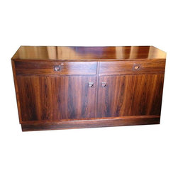 Pre-owned  Brouers Mobelfabrik Danish Sideboard Buffet - A Brouers Mobelfabrik Danish Rosewood Sideboard Buffet. There are a few minor scratches on the top, a photo of a scratch near the upper right hand corner is included. Also included is a photo of the left and right side interior cabinets, the left and right side drawers (the drawer on right has a built-in sliding tray), a photo of the right side which shows the beautiful grain in the wood, and a photo of the Brouers Mobelfrabrik label on the back of the buffet.