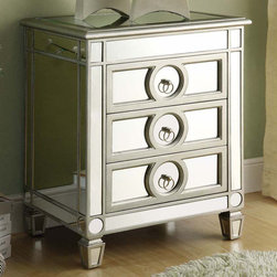 Monarch - Mirrored 3 Drawer Accent Table - Be the talk of the town with this mirrored accent table! This modern and edgy piece will no doubt be an eye catcher in your bedroom, hallway or living room. Its 3 drawers, with chic circular handles, offers you space to store your clothes, blankets, keys or accessories. Its smooth top surface is perfect for adding pictures or decorative items. Add this to your room along with the rest of our mirrored collection.