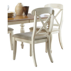 Liberty Furniture - Liberty Furniture Ocean Isle Traditional Side Chair w/ X Back in White, Beige (S - The tranquility of the sea and the charm of a cozy cottage harmonize in Ocean Isle. Ocean Isle creates incomparable style by combining coastal and cottage elements. Authentic pine veneers work well with the bisque finish to create a two tone natural look. This collection features louvered panels as well as x motif accents highlighted by satin nickel cup pull hardware. Elegantly styled and casually proportioned, Ocean Isle works in a dining room as well as a kitchen/dining combination. Tables feature canted corners and heavy turned legs. Pine Veneer tops contrast nicely with the bisque base. Two chair options feature napoleon styling with an x back and a saber leg or a splat back and a turned leg. Both chair seats are upholstered in nubby linen. The buffet features two top drawers, a center shelf with wine bottle storage and glass stemware holders flanked by two wooden doors for concealed storage. The sliding glass door hutch has x grid onlays as well as a bead board back panel with wood framed glass shelves. Touch lighting features a center can light. What's included: Side Chair (can only be purchased in sets of 2).