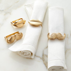 """Jonathan Adler - Mr. & Mrs. Muse Napkin Rings Set of Four - BRASS - Jonathan AdlerMr. & Mrs. Muse Napkin Rings Set of FourDetailsNapkin rings made of brass.Polished brass will develop a natural patina over time.Set includes two mustache napkin rings and two lips napkin rings.Each 2.5""""W x 1.5""""D x 1""""T.Designer About Jonathan Adler:Potter designer and author Jonathan Adler launched his first ceramics collection in 1994. His design philosophy: create a foundation of timelessly chic furniture and accessorize with abandon. With his roots still firmly in pottery he has expanded to become a complete lifestyle brand offering furniture lighting decorative objects fashion accessories and more. He is dedicated to bringing style craft and joy to life."""