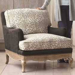 "Viva Terra - Leopard Print Eco Upholstered Chair - Organic cotton ticking combines with pure linen to cover our comfortableand totally eco chair. It's constructed with recycled fibers,down pillow fill and a certified kiln-dried hardwood frame. Thebottom is studded where fabric attaches to frame; removable coversprotect the armrests. Made in USA.35""W x 38""D x 32""H"