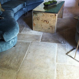 Antique Reclaimed French Blonde Barr limestone flooring - The grandest of stone floors, these antique reclaimed flagstones have a beautiful patina and texture that only time can produce. Quarried from the Languedoc area of France, the large flagstones work beautifully in contemporary as well as traditional settings. Once covering the floors of French chateaux, manor houses, and monasteries, the stone immediately will impart a feeling of permanence and history.