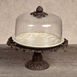 GG Collection Dessert Pedestal with Dome and Plate - Cream - This Gerson GG Collection Gracious Goods Dessert Pedestal with Dome and Plate – Cream makes a lovely countertop display for cakes, pies, and cookies, and can double as an elegant centerpiece for serving dessert on festive and formal occasions. The scrolling openwork edge of the brown cast aluminum base is complemented by a scrolling leaf motif on the ceramic plate's border and a cast aluminum finial cone atop the glass dome lid.