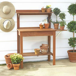 Wood Potting Bench - I've always thought potting benches were charming. This one would make a lovely home for a potted herb garden.