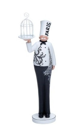 Resin French Chef Statue - 17H in. - All ready to serve up some haute cuisine, the Resin French Chef Statue - 17H in. adds French-inspired charm to any kitchen or dining room. Made of high-quality resin, he carries a serving tray and is all decked out in his black and white chef's uniform, which highlights his slender silhouette. An Eiffel Tower motif runs along one of his sides, and a suction cup base provides extra stability.