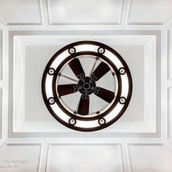 Modern Ceiling Fan Light - A unique ceiling fan light set against an expertly trimmed ceiling.
