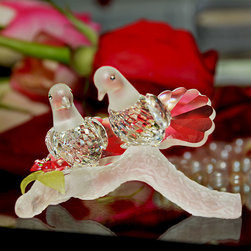 """Crystal Gifts 'With Love"""" - The crystal love doves are made of the finest Bohemian crystal from the Czech Republic. These crystal doves feature an exquisite combination of cut crystal and frosted crystal. The doves stand on a frosted crystal branch with a frosted crystal flower with leaves. The crystal love doves are manufactured by Preciosa, a world-class producer of fine crystal, and comes with a certificate of authenticity."""