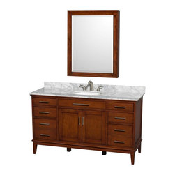 Wyndham Collection - 60 in. Eco-Friendly Single Sink Vanity with Medicine Cabinet - Includes white Carrera marble countertop with backsplash. Undermount oval porcelain sink. Faucet not included. Engineered to prevent warping and last a lifetime. 12-stage wood preparation, sanding, painting and hand-finishing process. Highly water-resistant low V.O.C. sealed finish. Transitional styling. Practical floor-standing design. Deep doweled drawers. Fully-extending under-mount soft-close drawer slides. 8 in. widespread 3-hole faucet mount. Concealed soft-close door hinges. Plenty of storage and counter space. Single faucet hole mount. Metal exterior hardware with brushed chrome finish. Made from solid birch hardwood. Light chestnut finish. Backsplash: 60 in. W x 0.75 in. D x 3 in. H. Vanity with countertop: 60 in. W x 22 in. D x 35 in. H. Countertop: 60 in. W x 22 in. D x 0.75 in. H. Medicine cabinet: 28 in. W x 6.25 in. D x 36 in. H (72 lbs.). Vanity: 60 in. W x 22 in. D x 35 in. H (185 lbs.). Warranty. Care Instructions. Vanity Installation Instructions. Cabinet Installation Instructions. Counter Handling InstructionsBring a feeling of texture and depth to your bath with the gorgeous Hatton vanity series. A contemporary classic for the most discerning of customers. The Wyndham Collection is an entirely unique and innovative bath line. Sure to inspire imitators, the original Wyndham Collection sets new standards for design and construction. Compliments any bathroom.