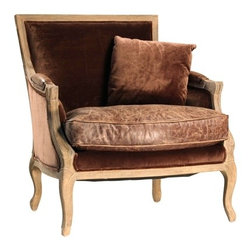 Jenny Arm Chair - The Jenny Arm Chair is crafted of a solid hardwood frame and upholstered in cotton velvet with hand-finished leather on arms and seat cushion. Pillow is included.