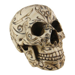 Zeckos - Tribal Tattoo Human Skull Statue Figure - This wickedly awesome skull figure/statue has a bone white finish, with a symmetrically carved tattoo pattern, accented by hand in black enamel. Made of cold cast resin, the figure stands 5 1/2 inches tall, is 7 inches deep, and 4 3/4 inches wide. It makes a great Halloween decoration, and is a great gift for any skull lover.