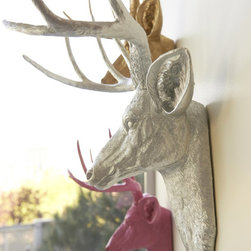 Faux Taxidermy Deer Heads - These deer heads are made from durable resin and come in white, black, silver, gold, bronze and even pink. Antlers can be ordered in a different color as well. More here: