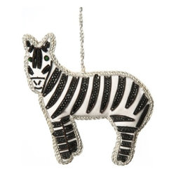Sitara Collections - Handcrafted Zardozi Ornament, Zebra - What's Black and White and (Cute) all Over? our Beautifully Crafted Zebra ornament, of Course. the Expertise of Each artist is Evident in Every Detail, including the Sequined Stripes That Separate this Zebra From the Pack. attach to a Tree Branch or Door Knob with the Striking Coiled Silver Cord. Color: Silver, Black and White. Shape: Zebra. Dimensioms: 4 inches Length X 4 inches High X .75 inches Deep. Materials: Fabric, Thread, Beads. Hanging instructioms: Hang with attached Loop.