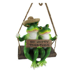 `Swingin` Singles` Frog Couple on Porch Swing - This adorable outdoor accent features a frog couple swinging on the porch on a summer evening, holding a plaque exclaiming that they are `So Hoppy Together.` Made of cold cast resin and lovingly hand-painted, this piece measures 9 1/4 inches long, 8 3/4 inches tall, and 6 3/4 inches deep. The swing features a rope hanger so you can easily hang it from a tree limb or on your porch or patio. It makes a lovely gift for frog fanatics.