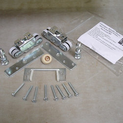 "Ball bearing rollers and hangers - The Christner Heavy Duty Pocket Door Frame utilizes the best hardware on the market with a pair of four  ball bearing rollers and hangers rated to carry 150 lbs.The ball bearing rollers will run maintenance free without ever being able to jump off the track. The hanger is attached to the top of the door with four 1 1/4"" screws"