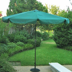 International Caravan - 8.2 Ft. Diam. Tilt and Crank Umbrella w Alumi - Color: BeigeIncludes a durable rust free aluminum pole. Base not included. Pictured in Forest Green. With Flaps. Crank and tilt mechanism. Polyester fabric cover. Complete weather proof protection against harsh weather and UV Light fading. 8.2 ft. dia. x 8 ft. H