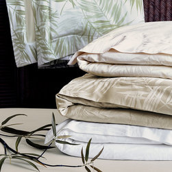 Frontgate - Isola Duvet Cover - 100% cotton sateen woven in Italy. 600-thread count. Choose from several calming colors. Machine Washable. Because this bedding is specially made to order, please allow 4-6 weeks for delivery.. Inspired by the emerald vegetation and sprawling castles of its namesake, our Isola Sateen Bedding Collection from Eastern Accents translates the best of tropical serenity to home decor. Lush palm leaves layer a rattan border to create a casual, elegant look with distinctive dimensional appeal. Isola's signature color, yarn-dyed Aloe, fosters a tranquility that enhances this collection's idyllic undertones.  .  .  .  . . Fabrics woven in Italy; sewn in the U.S.A.