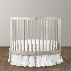 Ellery Round Crib & Mattress - I love a round crib because it enables you to float your crib in the center of the room if you desire. You aren't stuck putting it next to the wall.