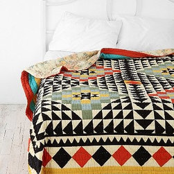 Kaleidoscope Patchwork Quilt - I love the use of pattern and colors on this amazing Kaleidoscope quilt!