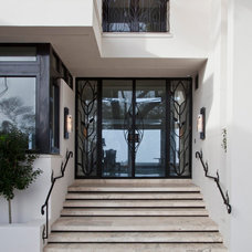 Contemporary Front Doors by Artesano Iron Works