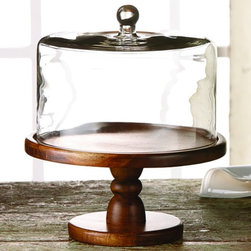"Jay Companies - Madera Small Wooden Cake Stand with Glass Dome - Define your presentation with a touch of class and keep the contents fresh while entertaining in an elegant fashion! An indispensable accessory for entertaining, our vintage wooden dessert pedestal creates an exquisite presentation of cakes, tarts, pies and more. The beauty of the solid piece of wood is intensified by a natural shine. Present this beautifully crafted cake plate as your wedding centerpiece or present as a hostess gift she will enjoy filling with baked confections for years to come.   * Dimensions: 9"" x 10.25"" H. Dome: 10.5""D  * Hand wash recommended  * Plate material: wood, glass dome included  * For alternate size see item J212766"