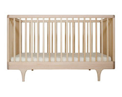 """Kalon Studios - Kalon Studios Caravan Crib Maple - Kalon Studios designs nursery furniture with a focus on contemporary form, innovative style and sustainability. Inspired by a storybook circus wagon, the Caravan crib offers playful and modern elements. This minimalist baby furnishing features slatted sides, two adjustable mattress heights and the option to convert to a platform toddler bed. Made in the USA from FSC-certified maple and low VOC, HAPs-free paint. Due to handmade and natural quality, slight color and grain variation may be present. 54.5""""W x 30""""D x 34""""H. Fits standard crib mattress (not included). Conforms to ASTM, CPSC and Health Canada regulations. Glue contains zero formaldehyde and exceeds European E1 and California emission standards by 3 times. Green guard certified."""