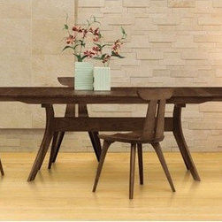 "Copeland Furniture - Audrey 66"" - 90"" Extension Dining Table - The double 'X' formation of the Audrey Dining Table trestle creates a state of dynamic tension giving the design a rigid base that provides diners with plenty of unobstructed leg room. These tables meet the needs of almost any dining space. The Audrey Dining Room is crafted in solid American black walnut hardwood. Features: -Finish: Natural walnut. -Clear finish that is silky, smooth to the touch, still tough enough to stand up to the wear and tear of daily family activities. -Natural hardwoods have specific characteristics that make them warm and appealing to the eye. -Swirls, knots and burls are some characteristics that contribute to the natural beauty of finely crafted hardwood furniture. -Hardwoods oxidize or change color, from exposure to direct light. -Color of the wood will deepen over time and take on a warm glow and soft patina. -Preserve the beauty of the finish, simply clean the surface of the furniture with a soft damp cloth and then dry it thoroughly. -Care over the years to come will not require oil, polishes or cleaners."
