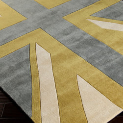 Cosmopolitan Rug - Grey and Gold - 8 x 11 - Strong diagonals and graphic patterns draw on heraldic inspirations � notably, the ever-enduring Union Jack pattern � to make their statement, but the Grey and Gold hues of the Cosmopolitan Rug look less to flags than to thunderclouds for their sophisticated palette and bold fields of color.  Hand-tufted, carved pile emphasizes the striking design.