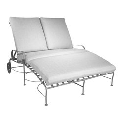 O.W. Lee - O.W. Lee Classico Double Chaise Lounge Multicolor - 958-DCHF - Shop for Chaise Lounges from Hayneedle.com! Enjoy time outdoors lounging with the person you love the most with the O.W. Lee Classico Double Chaise Lounge. Designed so two people can relax on the same chaise lounge you can cuddle talk enjoy a few drinks and spend some time together. This double chaise lounge is made from handcrafted wrought iron with Old World craftsmanship and brings style comfort and tranquility to your backyard. The basket weave design and gently curving armrests bring a graceful elegance to your patio that you're sure to love. The wheels allow you to easily maneuver it around your patio or deck. This double chaise lounge comes with your choice of Sunbrella cushions so you can complement your existing decor. Sunbrella cushions come with a five year warranty and are fade stain mildew and water resistant and are easy to clean with mild soap and water. Please note: This piece will be delivered with White Glove service which includes location placement. Unpacking and assembling the item will be left to the customer. Due to the custom-made nature of this item orders usually ship within approximately 5 weeks. Because each item is assembled just for you orders cannot be cancelled. A 50% restocking fee will apply for returns. This item is custom-made to order which means production begins immediately upon receipt of each order. Because of this cancellations must be made via telephone to 1-800-351-5699 within 24 hours of order placement. Emails are currently not acceptable forms of cancellation. Thank you in advance for your consideration in this matter. Materials and construction:Only the highest quality materials are used in the production of O.W. Lee Company's furniture. Carbon steel galvanized steel and 6061 alloy aluminum is meticulously chosen for superior strength as well as rust and corrosion resistance. All materials are individually measured and precision cut to ensure a smooth and accurate fit. Steel and aluminum pieces are bent into perfect shapes then hand-forged with a hammer and anvil a process unchanged since blacksmiths in the middle ages. For the optimum strength of each piece a full-circumference weld is applied wherever metal components intersect. This type of weld works to eliminate the possibility of moisture making its way into tube interiors or in a crevasse. The full-circumference weld guards against rust and corrosion. Finally all welds are ground and sanded to create a seamless transition from one component to another. Each frame is blasted with tiny steel particles to remove dirt and oil from the manufacturing process which is then followed by a 5-step wash and chemical treatment resulting in the best possible surface for the final finish. A hand-applied zinc-rich epoxy primer is used to create a protective undercoat against oxidation. This prohibits rust from spreading and helps protect the final finish. Finally a durable polyurethane top coating is hand-applied and oven-cured to ensure a long lasting finish. About SunbrellaSunbrella has been the leader in performance fabrics for over 45 years. Impeccable quality sophisticated styling and best-in-class warranties prove the new generation of Sunbrella offers more possibilities than ever. Sunbrella fabrics are breathable and water-repellant. If kept dry they will not support the growth of mildew as natural fibers will. Beautiful and durable Sunbrella is a name you can trust in your outdoor furniture. About O.W. Lee CompanyAn American family tradition O.W. Lee Company has been dedicated to the design and production of fine handcrafted casual furniture for over 60 years. From their manufacturing facility in Ontario California the O.W. Lee artisans combine centuries-old techniques with state-of-the-art equipment to produce beautiful casual furniture. What started in 1947 as a wrought-iron gate manufacturer for the luxurious estates of Southern California has evolved three generations later into a well-known and reputable manufacturer in the ever-growing casual furniture industry.