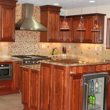 Traditional Kitchen Cabinets by Signature Cabinetry & Design Solutions