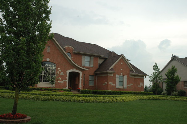 Traditional  by Land Architects, Inc.