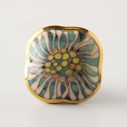 Cloisonne Chrysanthemum Pull - Ordinary bedroom furniture can be transformed with unique hardware. I would use these Art Nouveau–style drawer knobs to give a plain dresser some additional character.