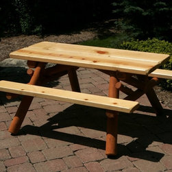 Moon Valley Rustic Furniture - Moon Valley 4 ft. Childrens Picnic Table - M400-UNFINISHED - Shop for Childrens Outdoor Furniture from Hayneedle.com! Kids need a place to picnic too. With the 4 ft. Children s Picnic Table they can have a spot just like the grownups. This table is made of white cedar and pine with a post-style frame and legs. Its beautiful wood grain shines through with amber spar or natural finish options. Plank seats and top make it easy to enjoy a snack or game.About Moon Valley Rustic FurnitureSince 1928 Moon Valley has been all about one thing: crafting the finest wooden outdoor furnishings for your home. Though times have certainly changed in the past 70 years Moon Valley's dedication to beautifully meticulously crafted products has remained constant. Starting with the finest northern white cedar or ponderosa pine each Moon Valley product is handcrafted using classic sturdy doweled construction which ensures lasting durability and function. An established family company with decades of experience Moon Valley remains true to old-fashioned dependability quality and impeccable customer service.