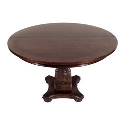 Pedestals & stands - A round carved pedestal Table, on a walnut color finish with walnut veneers on the top. Table opens to 86 inches.